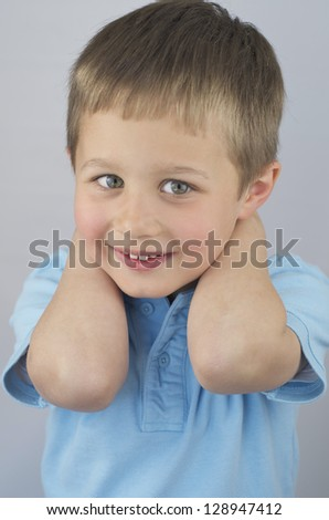 Cute Little Boy With Hands Behind His Head, Smiling - stock photo