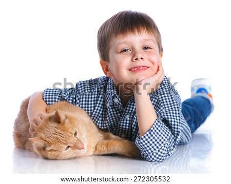 Cute little boy with his cat smiling at camera on isolated white background - stock photo