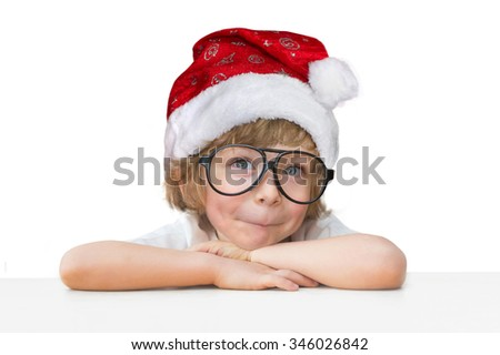 Cute little boy with Santa hat and toy glasses isolated on white background