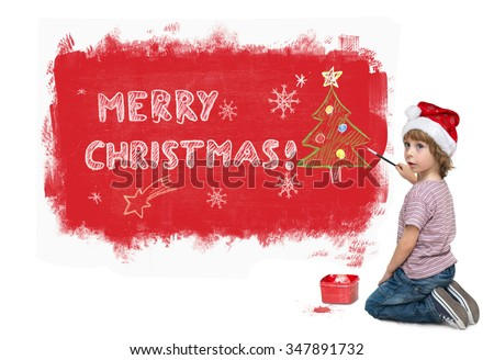 Cute little boy with Santa hat painting red Marry Christmas banner on the wall isolated on white background