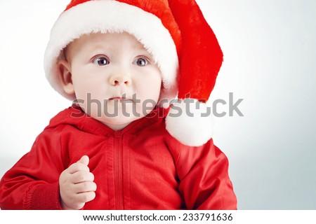 cute little boy with santa hat portrait - stock photo