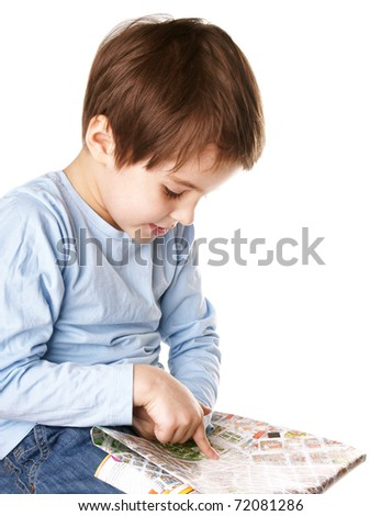 Cute little boy with the city map isolated on white backgrond