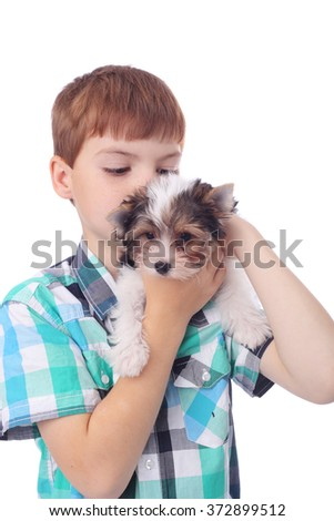cute little boy with the cute little puppy, focus on the dog - stock photo