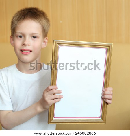 cute little boy with the diploma - stock photo