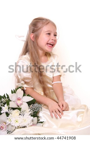 cute little bridesmaid with bunch of flowers