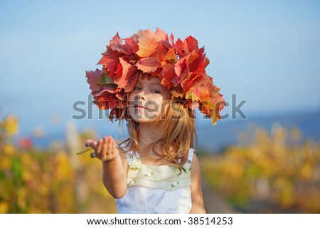 Cute little child girl in sunny autumn