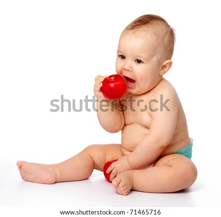 Cute little child is going to bite red apple, isolated over white