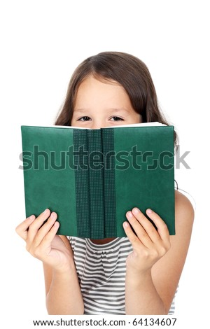 cute little child looking out of the book - stock photo