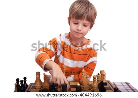 Cute little child playing chess - stock photo