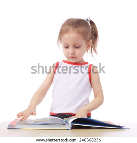 cute little child reading a book - stock photo