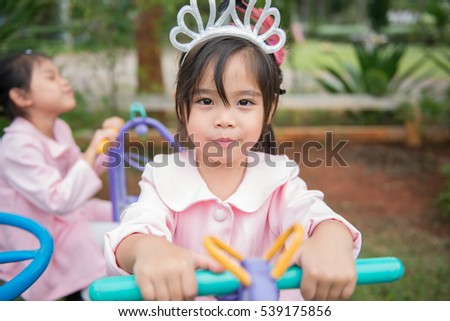 Cute little children play at playground with fun