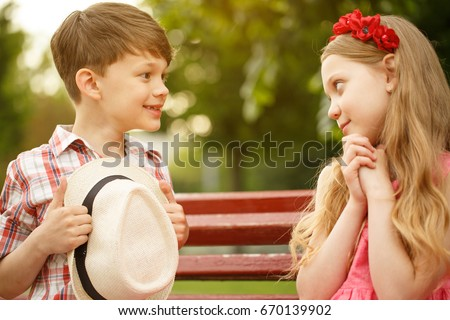 Cute little couple kids lovely boy stock photo edit now shutterstock cute little couple of kids lovely boy smiling at beautiful little girl sitting together at thecheapjerseys Gallery