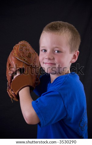 Cute little eight year-old boy with a baseball and glove.