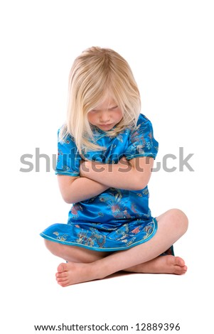 Cute little four year old girl refusing to listen - stock photo