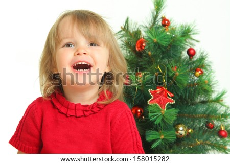 cute little girl and christmas tree - stock photo