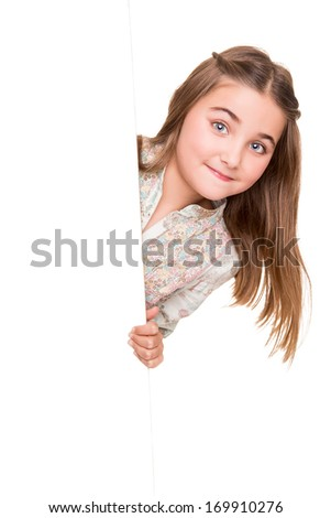 Cute little girl behind a white board - stock photo
