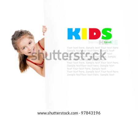 cute little girl behind a white board - stock photo