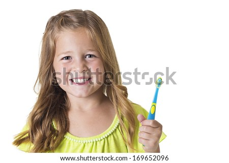 Cute Little Girl Brushing her teeth isolated on white - stock photo