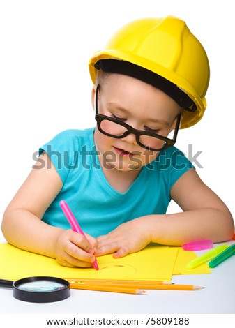 Cute little girl draw with marker wearing hard hat, isolated over white - stock photo
