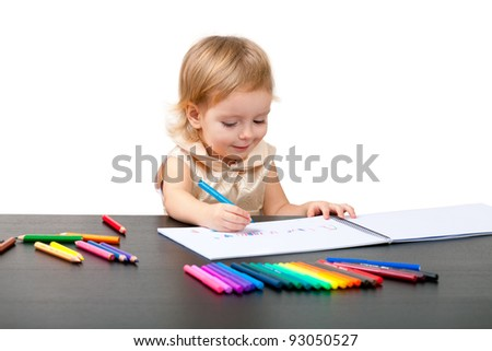 Cute little girl drawing. Isolated on white - stock photo