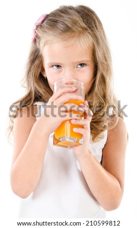 Cute little girl drinking orange juice isolated on a white background