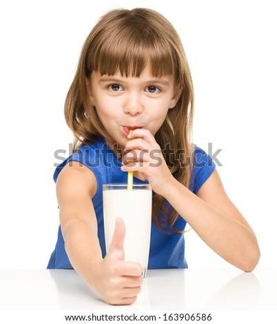 Cute little girl drinks milk, isolated over white - stock photo