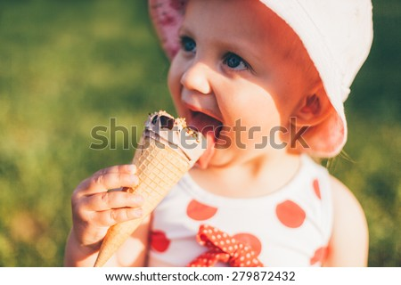 Cute Little Girl Eating Ice Cream - stock photo