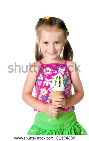 cute little girl eating ice cream on a white background - stock photo