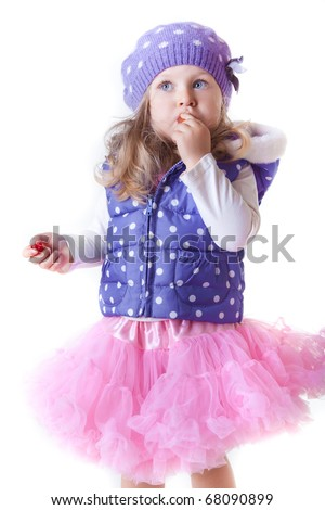 Cute little girl eating jelly candy - stock photo