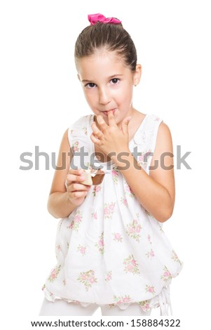 Cute little girl eating sweets - stock photo