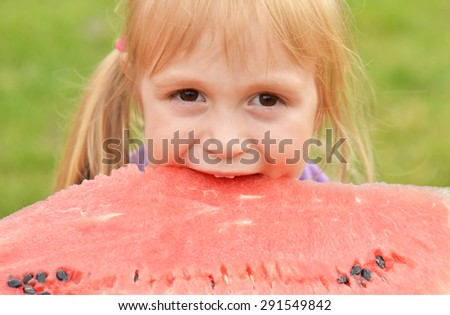 cute little girl eating watermelon  - stock photo