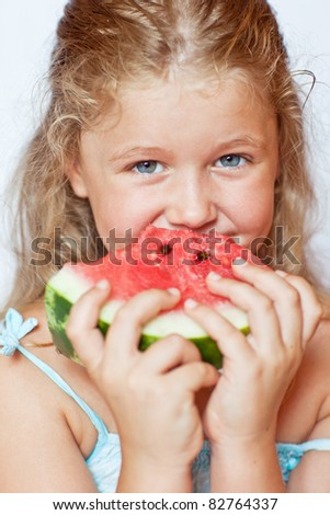 cute little girl eating watermelon  in summertime