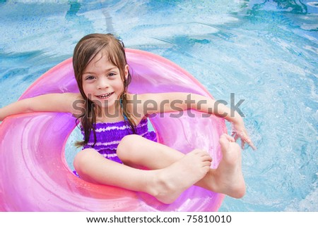 Cute little girl Happily playing in the swimming pool - stock photo