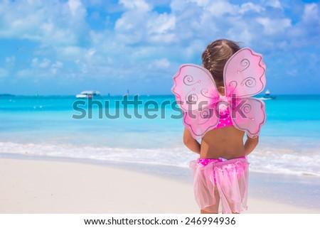 Cute little girl have fun on beach summer vacation - stock photo