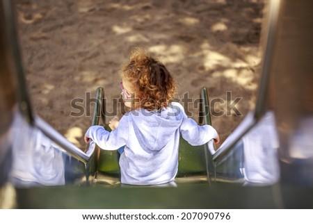 Cute little girl having fun - stock photo