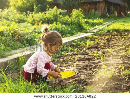Cute little girl having fun at countryside - stock photo