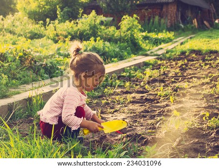 Cute little girl having fun at countryside. Toned - stock photo