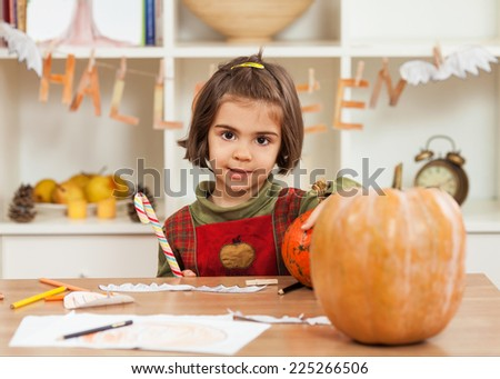 Cute little girl having fun for Halloween - stock photo