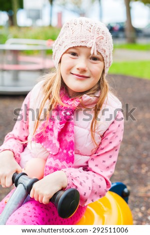 Cute little girl having fun on playground