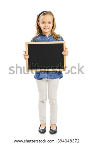 Cute little girl holding a chalkboard, isolated on white - stock photo