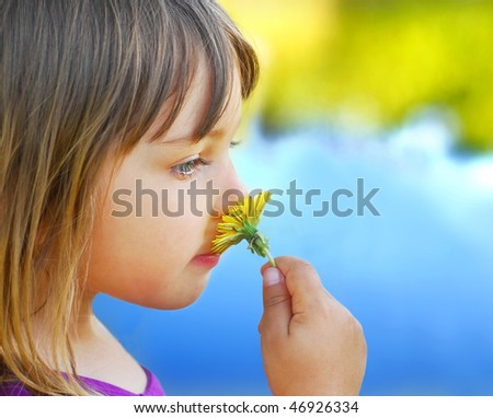 cute little girl holding a dandelion, - stock photo
