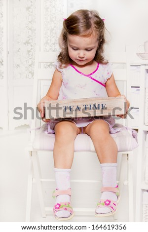 cute little girl holding a wooden box with tea bags stock photo. Black Bedroom Furniture Sets. Home Design Ideas