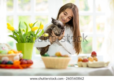 Cute little girl holding adorable bunny - stock photo