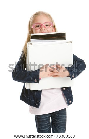 Cute little girl holding books isolated on white background - stock photo
