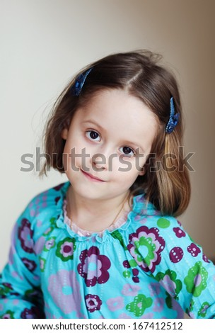 cute little girl in a blue dress - stock photo