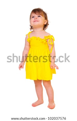 cute little girl in a yellow dress. portrait of a close-up in the studio. isolated on white - stock photo