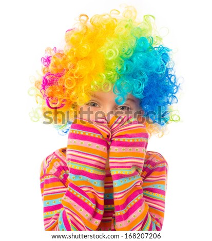cute little girl in clown wig isolated on white background - stock photo