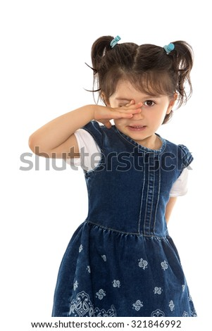 Cute little girl in fancy blue dress wipes his eyes-Isolated on white background - stock photo
