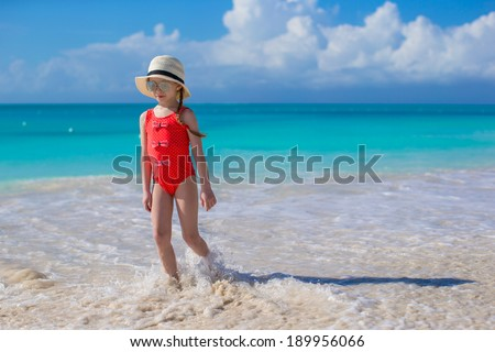 Cute little girl in hat at beach during caribbean vacation - stock photo