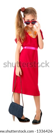 Cute little girl in her mother's dress and shoes, isolated on white - stock photo